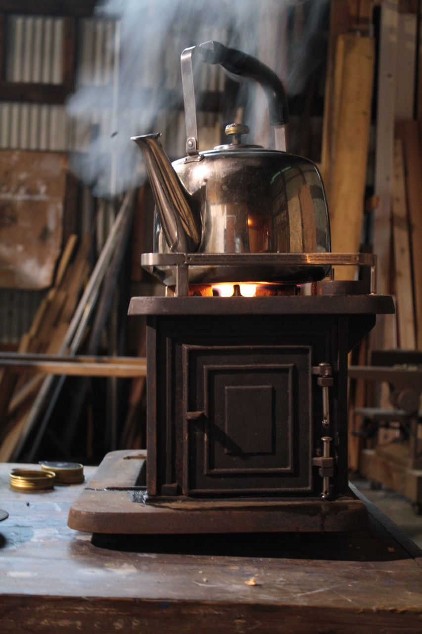 Making tea on the wood stove with the drop-in burner. - Little Cod Wood Stove – Bus Building Free Tea Party