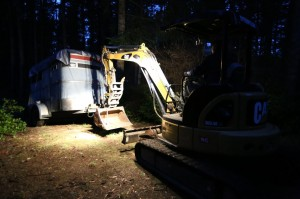 Levi hauls Freddie (the horse trailer) out of the muddy woods.