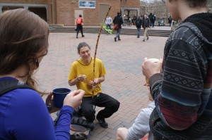 A fellow from the capoeira club plays the berimbau.
