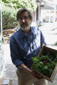 Dr. Glen Nagel offering some herbs for our herb garden.