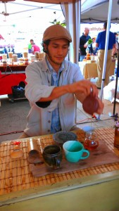 Arturo of Communitea Culture in Long Beach pours tee.