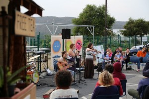 Friends play music at Soka's Garden Party