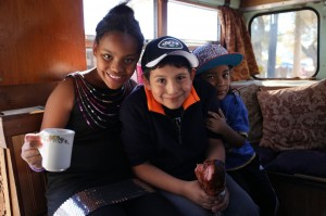 Some kids enjoy the tea bus.