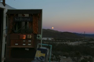 The moon rises over the Chisos Mountains as seen from the ghost town.