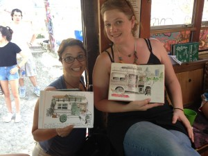 Two guests do watercolors of the tea bus in action at the Hope Outdoor Gallery.