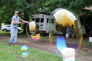 Cindy makes bubble with the kids.