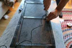 Making a window screen.