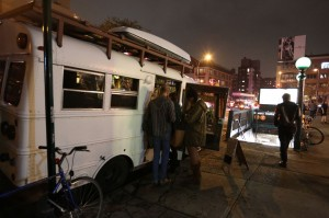 Folks gather in the tea bus near the subway station in The Bowery.