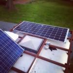 Installing Edna's new 320 watt solar panel.