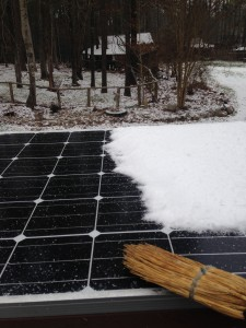 Sweeping snow off of Edna's solar panel.