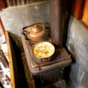Our Little Cod wood stove cooking tea and oatmeal mid-winter.