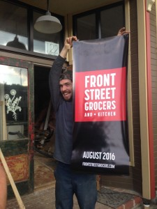 Corey holds a new banner.