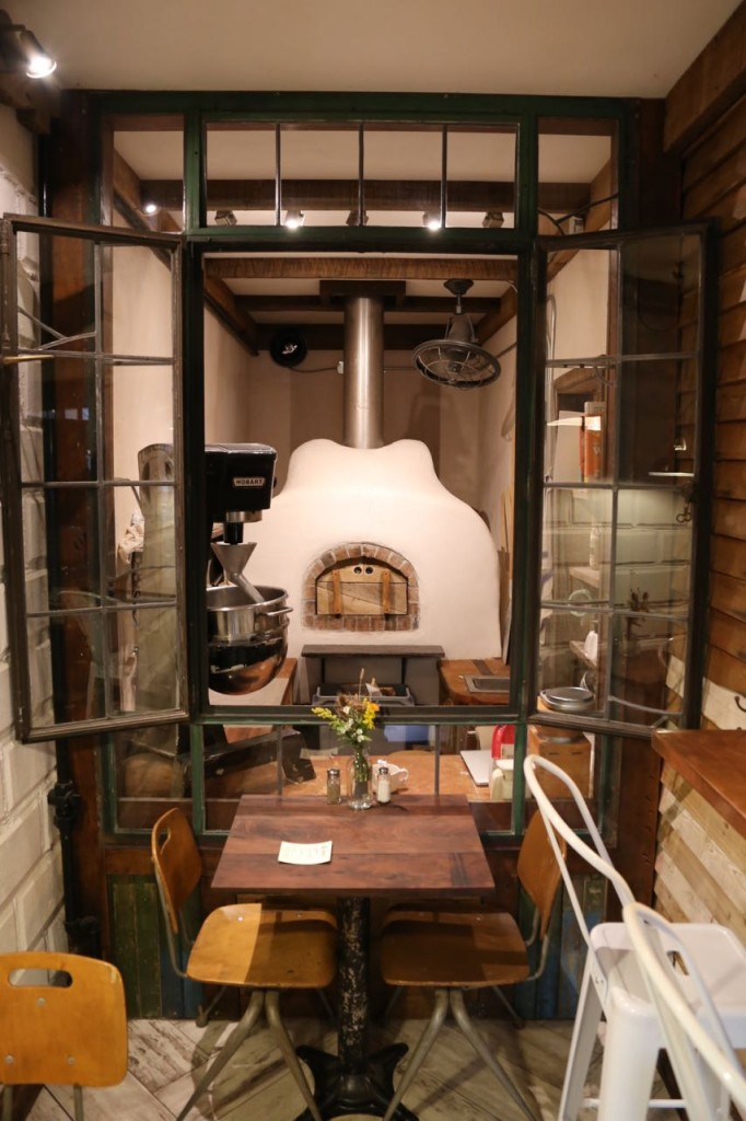 Where you can sit and watch things be baked in the wood-fired oven.