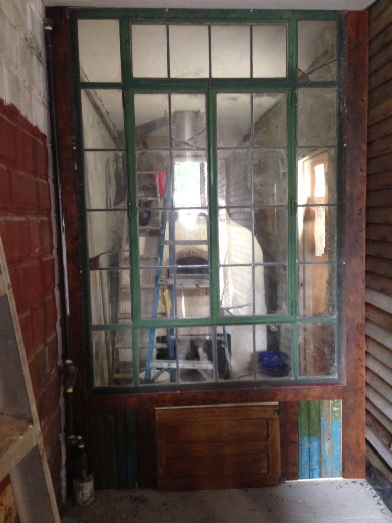 The metal-casement window from an old warehouse Justin picked up to separate the bakery from the seating area.