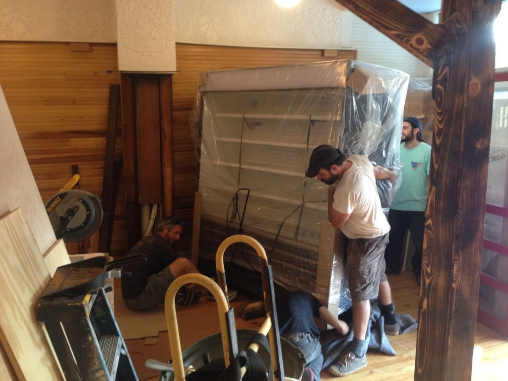 Bringing in each of the 4 fridges/freezers was no small task. At 600-900 lbs each, we needed 8 people, and had to take apart the front door frame.