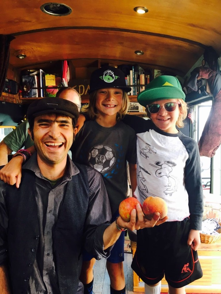 "Instagram Post: This is Colby and Buzz. They came aboard the Free Tea Bus last Sunday at the Crested Butte Farmers' Market. They were curious about free tea, and I told them, ""Some of your teachers or parents may not like that I say this, but I'm here to say that despite what we've been taught, money is not the most valuable thing in the world - relationships are.""  Their basic human instincts for Reciprocal Altruism kicked in when they came back later with gifts of a peach and an apple.  One of their moms, who was on the bus, later wrote in an email to me, ""Who knew two eight year old boys would enjoy a cup of tea and conversation?""  These are the kinds of genuine human interactions that I love about the tea bus. They inspire, bring out deep human instincts like sharing, and shift culture."